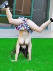 Leila does cartwheels topless outside