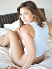 Miyu shows off her shaved pussy